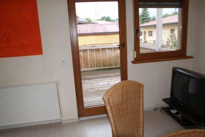 Wohnraum mit Balkon Wohnung 1
