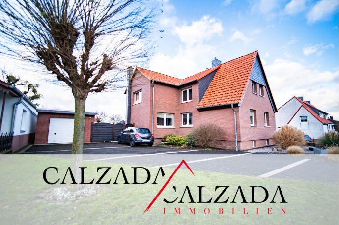 Einfamilienhaus in ruhiger & stadtnaher Lage - toller Garten mit Baugrundstück
