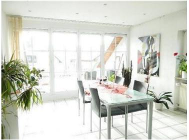Modernisierte 3,5 Zimmer-Wohnung mit Dachterasse und EBK in Kronau
