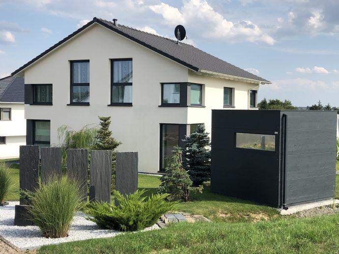 Einfamilienhaus mit Garten in Niederweiler