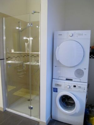 Main bathroom with washer and dryer