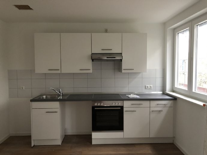2,5 Zi.-Neubau-Whg. mit Spitzboden, EBK, Balkon