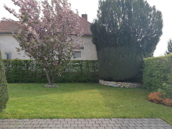 2 Zimmer - Wohnung mit Terrasse, Garten und Garage