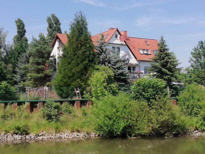Mehrfamilienhaus mit Gewerbeeinheit mit Saale Zugang