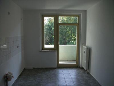Küche mit Balkonzugang