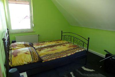 Schlafzimmer 1 im 1 Stock
