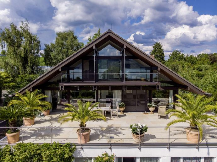 Charmantes Haus mit exzellentem Seeblick.