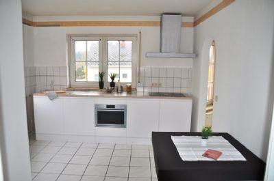 zweifamilienhaus in split level bauweise mit garten und doppelgarage in guter lage von brechen. Black Bedroom Furniture Sets. Home Design Ideas