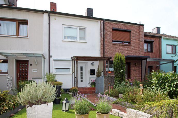 Charmantes RMH mit Terrasse, Garten und Garage.