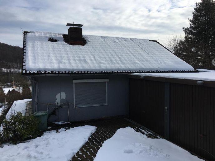 Hübsches Einfamilienhaus mit Garage unweit des Ortskerns!