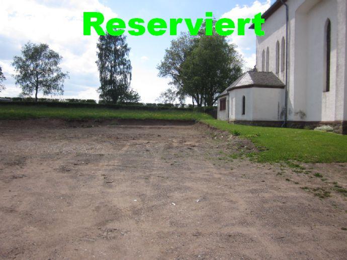 Teilerschossenes Baugrundstück in Großkampenberg/Eifel.