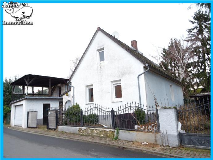 Schöneck Büdesheim: sanierungsbedürftiges Einfamilienhaus mit Doppelgarage und Nebengebäude