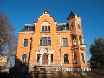 Backsteinvilla mit Granit- und Sandsteinelementen