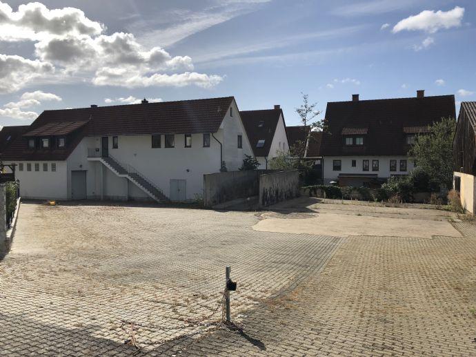 Wohn- und Gewerbeobjekt mit Baugrundstück und Garten.