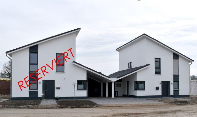KFW 40: Exklusive Doppelhaushälfte in bevorzugter Lage