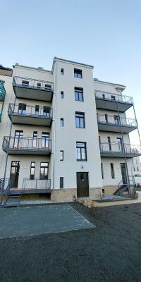 Erstbezug  3 Zimmer Erdgeschosswohnung in historischem Gebäude mit allen Annehmlichkeiten: Fußbodenheizung, Kaminanschluss, Balkon, Terrasse