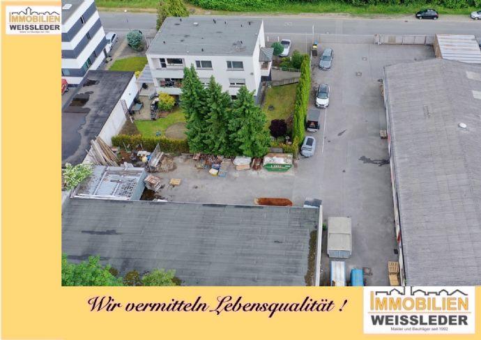 Wohn- und Geschäftshaus mit Werkhalle,Lagerhalle,Sozialräumen und drei Garagen !!!!