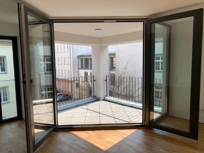 Erstbezug: stilvolle 3-Zimmer-Wohnung mit Balkon, Einbauküche und Tiefgaragenstellplatz in Rostock