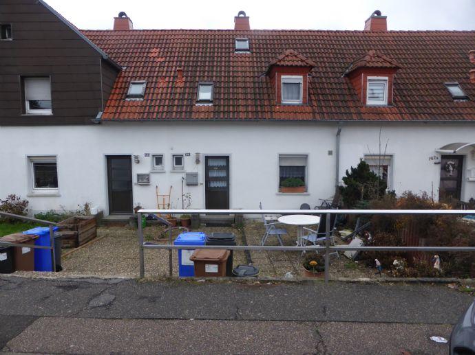 Einfamilienhaus als Reihenmittelhaus am Sommerwald;