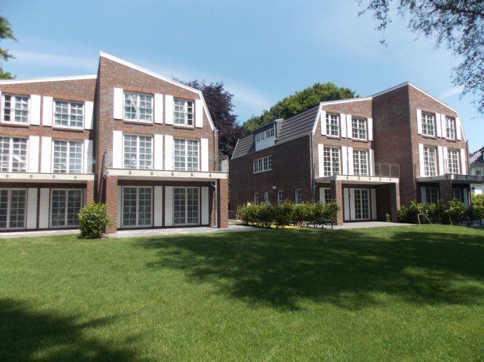 Attraktive 3 Zimmer Maisonette-Wohnung mit großer Terrasse und Garten