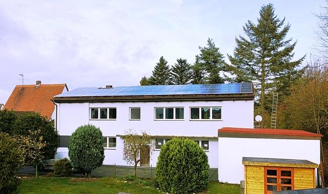 Energetisch saniertes Mehrfamilienhaus mit Garten und Sonnenbalkonen