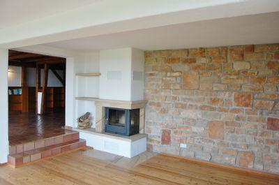 Wohnbereich mit offenem Kamin