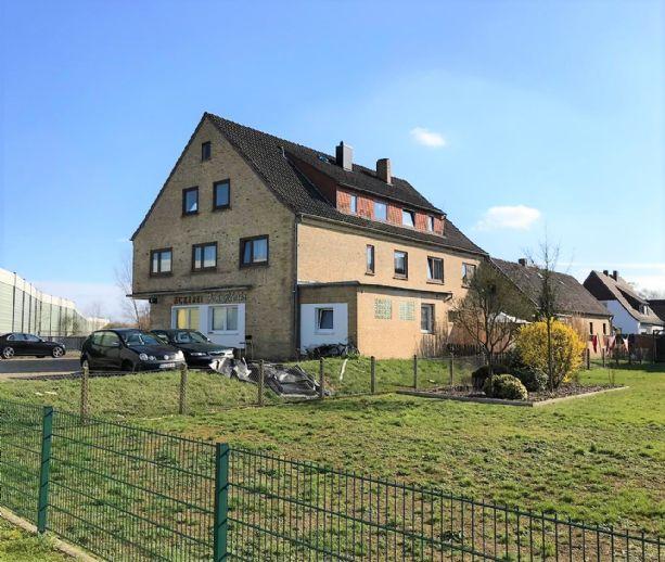 Kapitalanleger aufgepasst - Solides 6-Parteienhaus in Stuhr zzgl. Grundstück mit Baugenehmigung für 5-Parteienhaus