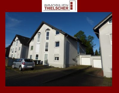 Helle nach Westen ausgerichtete Doppelhaushälfte mit 3 WE, Garten, Garage und 2 Stellplätzen.