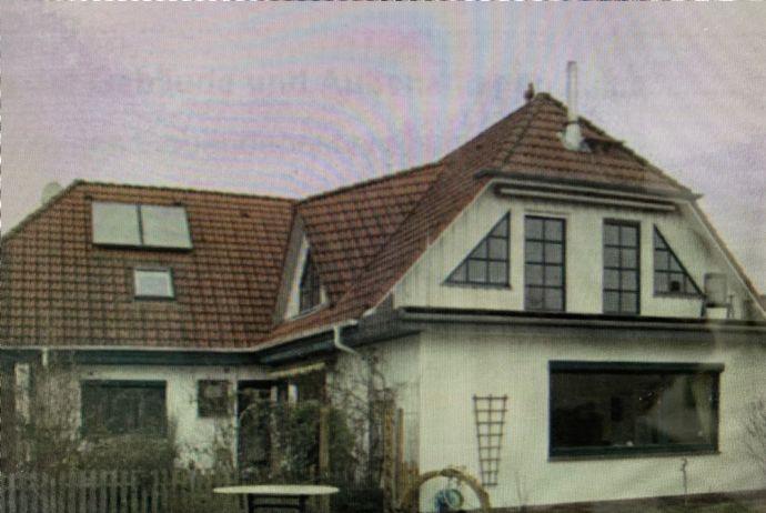 Schöne 5-Zi.-Whg. mit Kamin,Terrasse, Garten in Stuhr-Seckenhausen mit Sanierungsbedarf