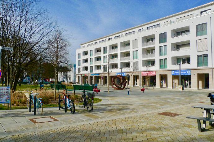 Attraktive sonnige 2-Zimmer-Neubau-Wohnung mit Süd-Loggia, moderner Einbauküche und Stellplatz am Martinsplatz/Martinsried