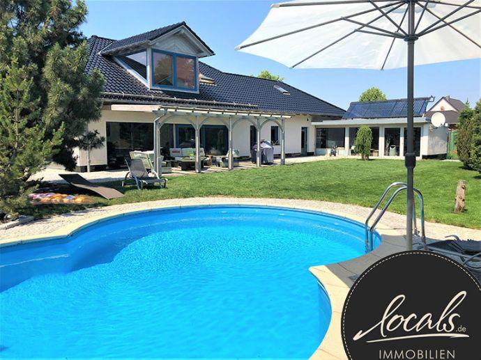 Einfamilienhaus mit Pool auf ca.1200 m² Sonnengrundstück!