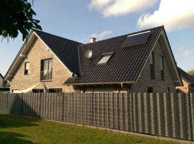 Exklusive Dachgeschosswohnung im 2-Familienhaus mit Balkon
