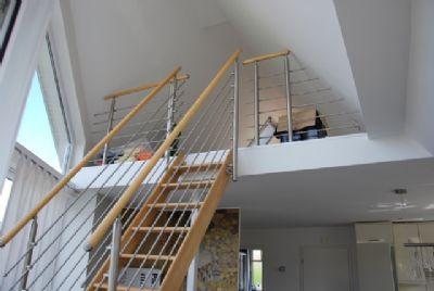Wohnraum im OG mit Galerie und Schlafraum im Dachg