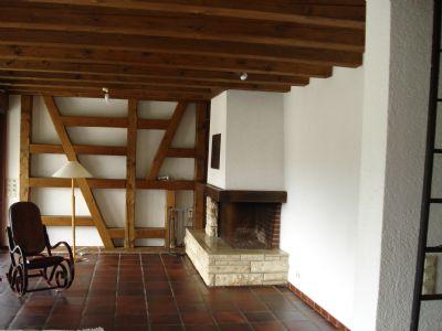Bild 7Wohnzimmer mit Kamin, oben Lesegalerie