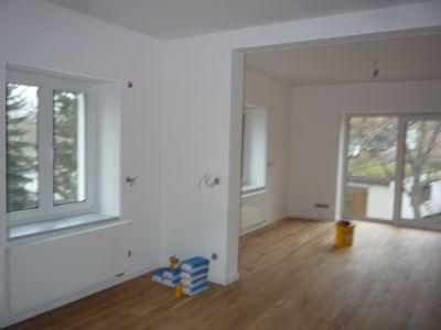 Wohnzimmer/Küche mit Balkonaustritt
