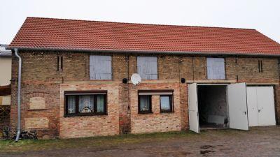 linkes Seitengebäude 1 WE + Garagen