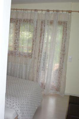 Schlafzimmer mit angrenzender Terrasse W-1