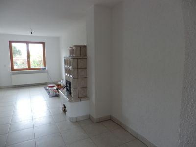 Teilansicht Wohn- Esszimmer mit Kachelofen