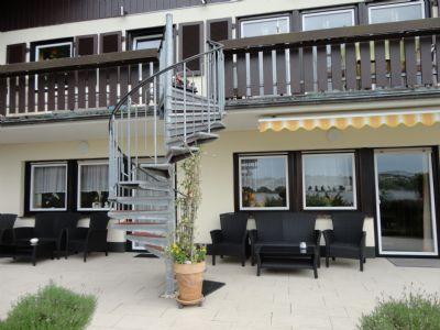 EG mit Balkon  /  Souterrain mit Terrasse