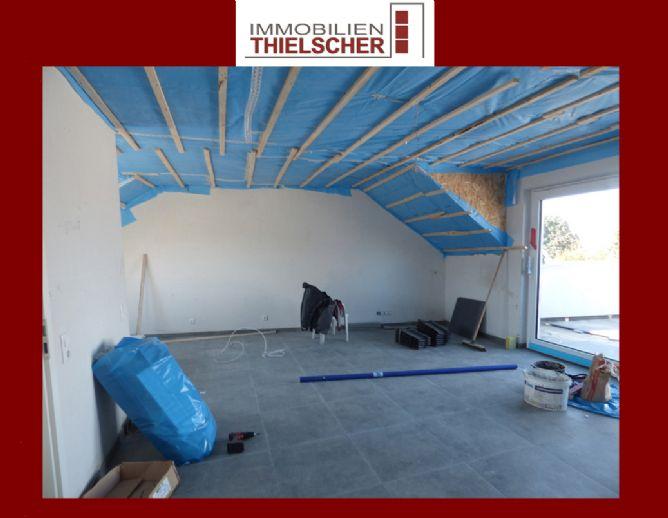 Moderne neugebaute 2 Zimmer Dachgeschosswohnung mit großer Sonnenterasse
