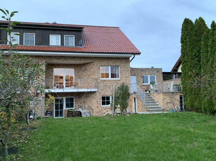 Schöne Doppelhaushälfte in ruhiger Ortsrandlage. Massive und ökologische Bauweise mit sehr gutem Raumklima