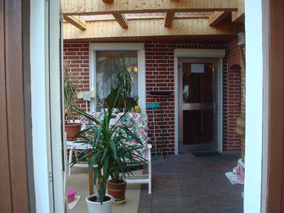 Wintergarten mit Zugang zur Küche