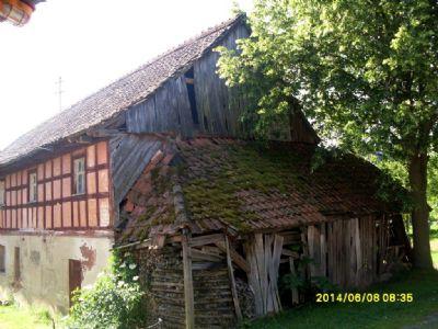 Stall & Scheune des Wohnstallhauses mit Holzlege